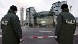 File Photo: German policemen in front of the main railway station in Berlin, Germany.  EPA, RAINER JENSEN