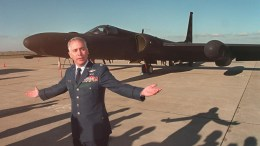 """US Air Force Lieutenant Colonel David Bonsi speaks to reporters in front of a U-2 reconnaissance plane. According to a report by the Central Intelligence Agency (CIA), the air force concealed from the public that what many believed were UFOs actually were Cold-War missions by the U-2 and its successor the SR-71 """"Blackbird"""". GEORGES GOBET"""