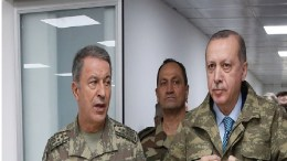 A handout photo made available by the Turkish Presidential Press Office shows Turkish President Recep Tayyip Erdogan (R) and Turkish Chief of Staff General Hulusi Akar (L) at the a military command center which is commanded of Olive Branch in Hatay, Turkey, 25 January 2018. EPA, TURKISH PRESIDENTAL PRESS OFFICE HANDOUT, EDITORIAL USE ONLY