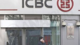 PHILE PHOTO A Chinese man using an iPhone walks past a branch of the Industrial and Commercial Bank of China (ICBC) in Beijing, China, 17 February 2016. Reports stated that the Apple Pay mobile payment system is expected to be available for customers of ICBC and other banks in China on 18 February.  EPA,ROLEX DELA PENA