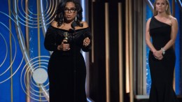 A handout photo made available by the Hollywood Foreign Press Association (HFPA) on 08 January 2018 shows Oprah Winfrey (L) accepting the Cecil B. DeMille Award for her 'outstanding contribution to the entertainment field' as Reese Witherspoon (R) looks on during the 75th annual Golden Globe Awards ceremony at the Beverly Hilton Hotel in Beverly Hills, California, USA, 07 January 2018. EPA, HFPA HANDOUT.