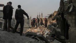 File PHOTO: Civilians and White Helmets volunteers search for survivors after several air strikes destroyed civil buildings in Hamoria city, al-Ghouta, Syria. The White Helmets volunteers pulled out more than 15 survivors, and at least 17 people got killed in the air strikes in the city, while a total of at least 27 people got killed on the day in the eastern Ghouta region. EPA, MOHAMMED BADRA