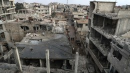 A view of destroyed buildings in the aftermath of airstrikes in Syria.  EPA, MOHAMMED BADRA