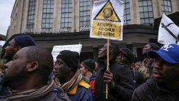 A man holds a placard saying 'Attention, watch dog' during a protest against the policy of Belgium's State Secretary for Asylum Policy, Migration and Administrative Simplification, Theo Francken, in Brussels, Belgium. Around 250 people gathered to protest against the nationalist Belgian state secretary member of NVA party and blame that Sudanese refugees deported from Belgium were tortured upon their return. Francken invited Sudanese officials to Brussels in September to help authorities identify Sudanese migrants to support their forced repatriation. EPA, OLIVIER HOSLET