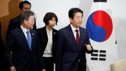 FILE PHOTO. South Korean President Moon Jae-in (R) and Japanese Prime Minister Shinzo Abe (L) arrive for their meeting in PyeongChang, South Korea. EPA, KIM HONG-JI, POOL