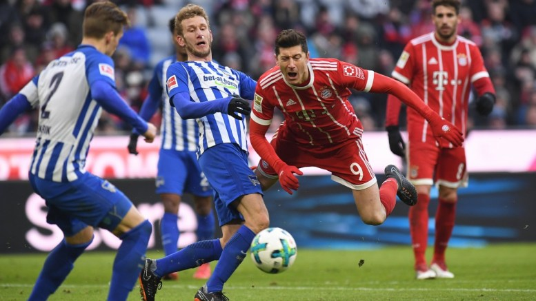 Berlin's Fabian Lustenberger (L) in action with Bayern's Robert Lewandowksi (R) during the German Bundesliga soccer match between FC Bayern Munich and Hertha BSC Berlin, in Munich, Germany, 24 February 2018. EPA, LUKAS BARTH EMBARGO CONDITIONS