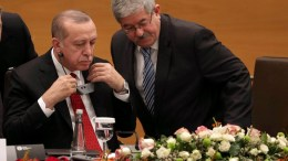 President of Turkey Recep Tayyip Erdogan  (R) speaks with Algerian Prime Minister Ahmed Ouyahia (L) during the Algerian-Turkish Business Forum in Algiers, Algeria, 27 February 2018.  EPA, STR