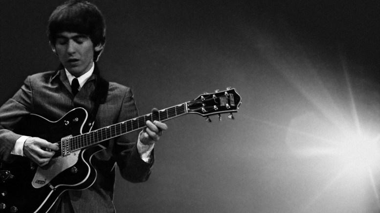Α photograph of the Beatle George Harrison playing the guitar during a concert in 1964. File Photo. EPA, MIKE MITCHELL