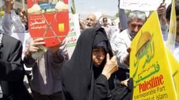 File Photo: Μια γυναίκα κατά τη διάρκεια συγκέντρωσης στην Τεχεράνη EPA, ABEDIN TAHERKENAREH