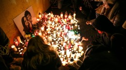 People light candles during a candlelight vigil for murdered Slovak journalist Jan Kuciak in Bratislava, Slovakia, 26 February 2018. Kuciak was found shot dead together with his girlfriend Martina in Velka Maca near Bratislava. EPA, DAVID DUDUCZ