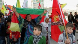 Syrian Kurdish refugees carry the Kurdish YPG forces flag during a demonstration against the military operation by the Turkish army against the Kurdish YPG forces in Syria's Afrin, in Sulaymaniya, Kurdistan Region of Iraq. EPA, AFAN ABDULKHALEQ