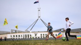 Kids are seen playing soccer in front of Parliament House during a rally outside Parliament House in Canberra, Australian Capital Territory, Australia. File Photo. EPA, LUKAS COCH AUSTRALIA AND NEW ZEALAND OUT