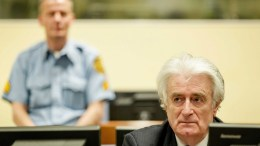 File Photo: Bosnian Serb wartime leader Radovan Karadzic (R) sits in the courtroom for the reading of his verdict at the International Criminal Tribunal for Former Yugoslavia (ICTY) in The Hague.   EPA, ROBIN VAN LONKHUIJSEN