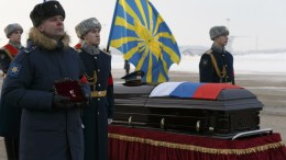 Russian honor guards stand next to a coffin with the body of Russian Roman Filipov, the pilot of the Su-25 jet who ejected after Syrian insurgents shot down his plane, traded fire with militants on the ground and then blew himself up to avoid being captured, during a farewell service at Chkalovsky military airport, just outside Moscow, Russia, 08 February 2018. EPA, VADIM SAVITSKY,  RUSSIAN DEFENSE MINISTRY , POOL