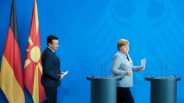 Prime Minister of the FYROM Zoran Zaev (L) and German Chancellor Angela Merkel during a joint press conference at the Chancellery in Berlin, Germany, 21 February 2018. EPA, HAYOUNG JEON