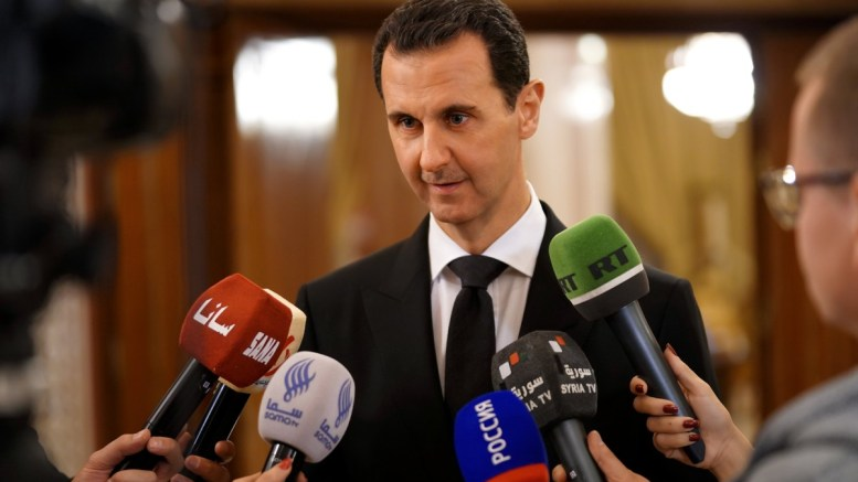 A handout photo made available by the official Syrian Arab News Agency (SANA) shows Syrian President Bashar al-Assad speaking to reporters in Damascus, Syria. EPA, SANA HANDOUT, EDITORIAL USE ONLY