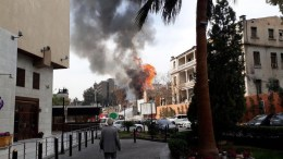 A handout photo made available by the Syrian Arab News Agency (SANA) showing flame and smoke rising after a fire broke out when a mortar shell exploded in the vicinity of the old Damascus Fairground, FILE PHOTO. EPA, SANA HANDOUT HANDOUT EDITORIAL USE ONLY, NO SALES