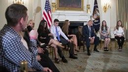 Marjory Stoneman Douglas High School shooting survivor Samuel Zeif (L) delivers remarks as US President Donald J. Trump listens during a listening session with high school students and teachers in the State Dining Room of the White House in Washington, DC, USA, 21 February 2018. Families from the Parkland, Newtown and Columbine communities attended the meeting. EPA, SHAWN THEW