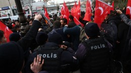 Turkish leftist protestors scuffle with riot police during an illegal demonstration against the visit of US Secretary of State Rex Tillerson in front of the hotel where Tillerson and Turkish Foreign Minister Mevlut Cavusoglu were to meet, in Ankara, Turkey, 16 February 2018. Tillerson was in Turkey for talks about the Turkish army's operation against the Kurdish Popular Protection Units (YPG) forces in Afrin, Syria. EPA, STRINGER