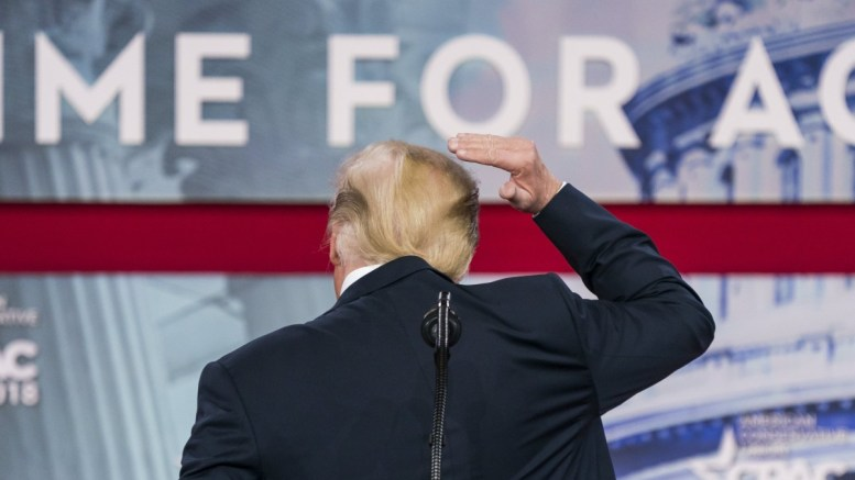 US President Donald J. Trump pretends to fix his hair as he addresses the 45th annual Conservative Political Action Conference (CPAC) at the Gaylord National Resort & Convention Center in National Harbor, Maryland EPA, JIM LO SCALZO