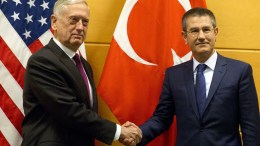 US Secretary for Defense Jim Mattis (L) with Turkish Defense Minister Nurettin Canikli prior to a meeting at NATO headquarters in Brussels, Belgium, 14 February 2018. NATO defense ministers begin a two-day meeting Wednesday to focus on military spending, cooperation with the European Union, and assistance to the Iraqi army. EPA, VIRGINIA MAYO, POOL