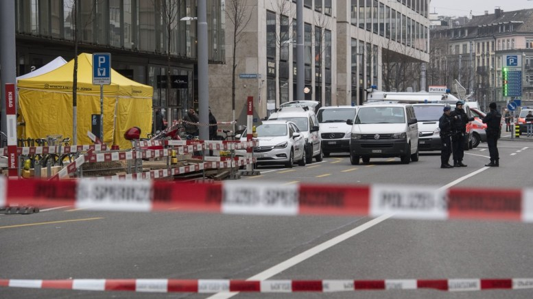 Forensic experts and Swiss police secure evidence at the cordoned off crime scene of a shooting outside a bank in Zurich, Switzerland, 23 February 2018 in which two people reportedly have been killed.  EPA, ENNIO LEANZA