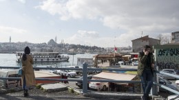 People stand at the Halic Bay on a sunny day in Istanbul, Turkey 06 February 2018. EPA, TOLGA BOZOGLU