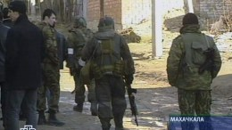 FILE PHOTO. A television grab taken from Russian NTV television channel shows special task forces an ongoing siege of two houses where people, suspected of terrorist activities, have taken shelter. EPA, NTV NTV TV GRAB