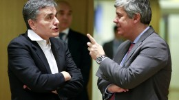 Greek Finance Minister Euclid Tsakalotos (L) and President of the Eurogroup, Portuguese Finance Minister Mario Centeno speak at the start of a Eurogroup Finance Ministers' meeting, at the EU Council, in Brussels, Belgium, 19 February 2018. EPA, OLIVIER HOSLET
