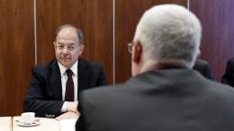 File Photo: Turkish Deputy Prime Minister Recep Akdag (L) talks to Hungarian Minister of Human Resources Zoltan Balog. EPA, Szilard Koszticsak HUNGARY OUT