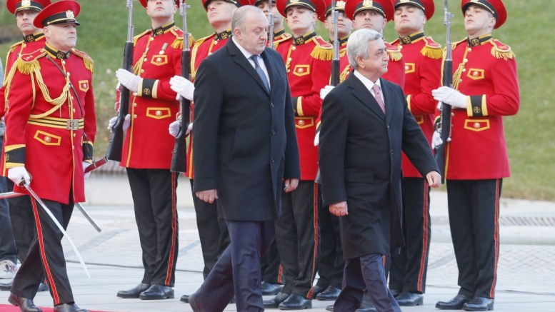 File Photo: Georgia's President Giorgi Margvelashvili (L) and President of Armenia Serzh Sargsyan (R) inspect the honor guard during the welcoming ceremony at the President's residence in Tbilisi, Georgia. EPA, ZURAB KURTSIKIDZE