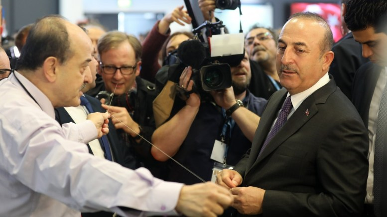 File Photo: Turkish Foreign Minister Mevlut Cavusoglu (R) visits a exhibitor stand during his visit to the Turkish hall in the International Travel Trade Show, in Berlin, Germany. EPA, FELIPE TRUEBA
