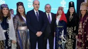 File Photo: Turkish Foreign Minister Mevlut Cavusoglu (C) and Turkish Minister of Culture and Tourism, Numan Kurtulmus (3-L) pose with some exhibitors during their visit of the Turkish hall in the International Travel Trade Show, in Berlin, Germany. EPA, FELIPE TRUEBA