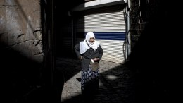 A Kurdish woman walks on street at Sur neighborhood in Diyarbakir, 880km southeast of Ankara, Turkey. Kurdish people will celebrate Newroz on 21 March. Newroz or Nowruz, which means 'new day' in the Persian language, and it marks the arrival of spring and the first day in the Iranian calendar. It is widely celebrated in the Persian and neighboring regions. EPA, SEDAT SUNA