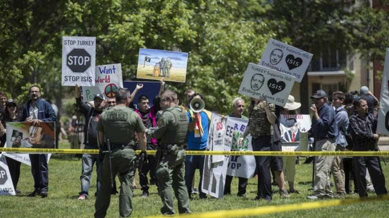 File Photo: Opponents of President of Turkey Recep Tayyip Erdogan rally in Lafayette Park in Washington, DC, USA. EPA, SHAWN THEW