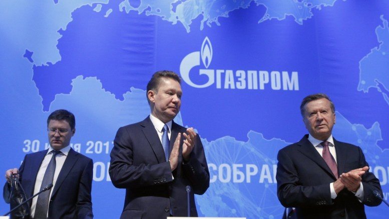 File Photo: Chairman of Gazprom Management Committee Alexei Miller, board of directors chairman Viktor Zubkov and Russian Energy Minister Alexander Novak arrive for the annual Gazprom shareholders meeting in Moscow, Russia. EPA, SERGEI CHIRIKOV
