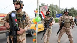 FILE PHOTO.  Iraqi soldiers meet with local drivers at a checkpoint. EPA, ALI ABBAS