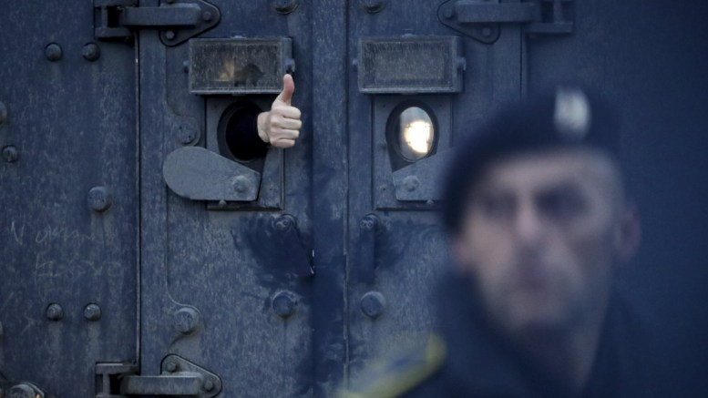 File Photo: The head of the Serbian government's Office for Kosovo, Marko Djuric, gives a thumb out of the armored vehicle of Kosovo's police special unit in Pristina, Kosovo, 26 March 2018. Kosovo Police special unit detained head of the Serbian government's Office for Kosovo, Marko Djuric, in northern city of Mitrovica for entering Kosovo despite a ban on his presence. EPA, VALDRIN XHEMAJ
