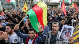 File Photo: Lebanese and Syrian Kurds living in Lebanon carry national flags and placards as they shout slogans during a protest against Turkey. EPA, NABIL MOUNZER