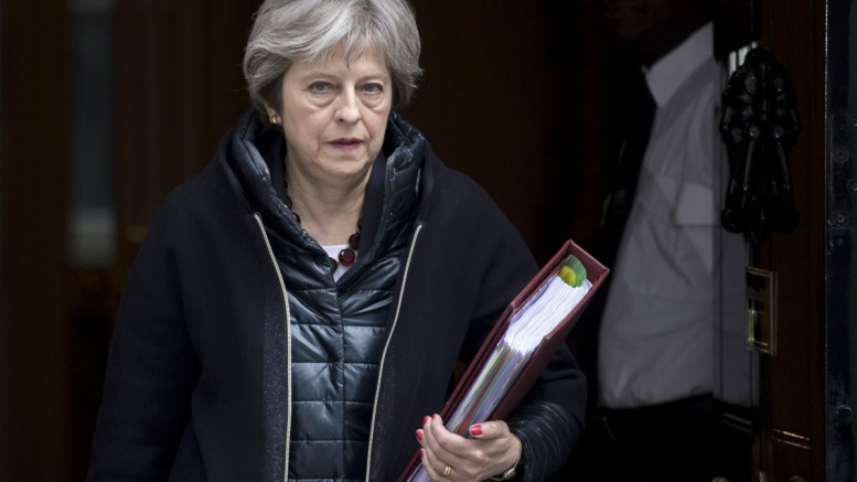 Britain's Prime Minister Theresa May leaves No. 10 Downing Street to attend the Prime Minister's Questions in the Houses of Commons, in London. EPA, WILL OLIVER