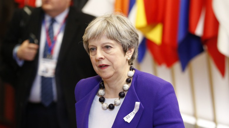 File Photo: British Prime Minister Theresa May leaves at the end of the first day of the European Council meeting in Brussels, Belgium. EPA, JULIEN WARNAND