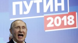File Photo: Russian President Vladimir Putin reacts as he meets with his confidants at his campaign headquarters in Moscow, Russia. EPA, SERGEI ILNITSKY
