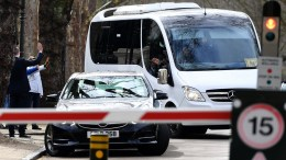 Russian diplomats and family members leave in a bus from the Russian Embassy in central London, Britain. EPA, ANDY RAIN