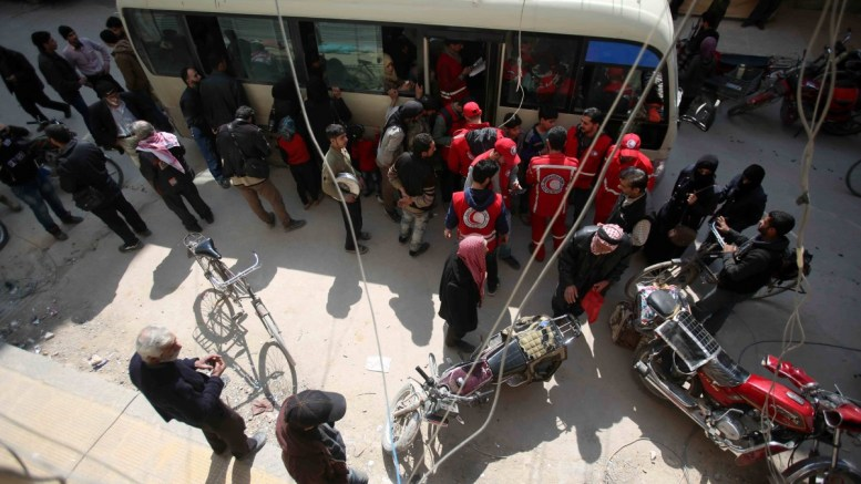 SARC employees organize people prior to evacuation, rebels-held Douma, Eastern Ghouta, 13 March 2018. EPA, STR
