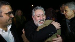 Turkish editor in chief of Cumhuriyet newspaper Murat Sabuncu (C) hugs his friends after he was released from the Silivri prison in Istanbul, Turkey, 10 March 2018. EPA, ERDEM SAHIN