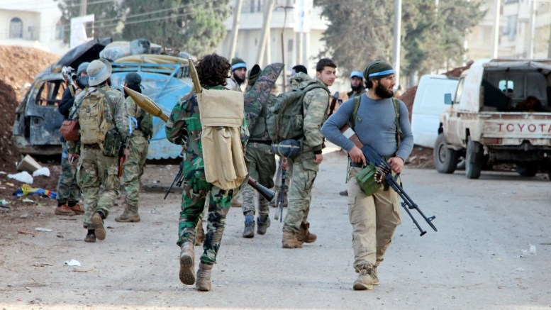 Turkey-backed Free Syrian Army soldiers take control of Afrin city center, Syria, 18 March 2018. The Turkish army on 20 January launched 'Operation Olive Branch' in Syria's northern regions against the Kurdish Popular Protection Units (YPG) forces and the Syrian Democratic Forces (SDF) which control the city of Afrin. EPA, DHA, DOGAN NEWS AGENCY