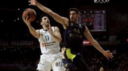File Photo: Real Madrid's Facundo Campazzo (L) and Fenerbahce's Ahmet Duverioglu (R) in action during their Euroleague basketball match at the Sports Palace in Madrid, Spain, 02 March 2018. EPA,Kiko Huesca