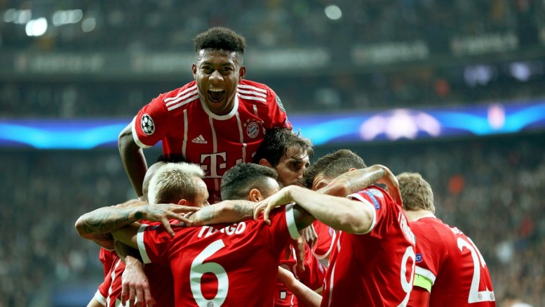 Bayern Munich's Thiago Alcantara (front 2-L) celebrates with his teammates after scoring the 1-0 lead during the UEFA Champions League round of 16, second leg soccer match between Besiktas Istanbul and FC Bayern Munich in Istanbul, Turkey, 14 March 2018. EPA,ERDEM SAHIN