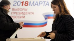 A woman casts her ballot in the Russian presidential elections at a polling station in Moscow, Russia, 18 March 2018. Eight candidates are contesting for the presidential seat, including the incumbent president Vladimir Putin, who is projected to win his fourth term in the Kremlin. EPA/MAXIM SHIPENKOV