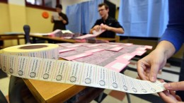 Polling station officials make final preparations ahead of the general elections, inside a polling station in Milan, Milan, 03 March 2018. General elections in Italy will be held on 04 March. EPA, DANIEL DAL ZENNARO